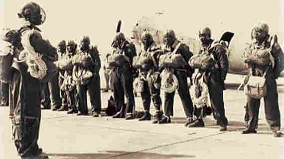 Army paratroopers of the 555th Parachute Infantry Battalion stand at ease during inspection.