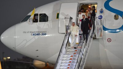 "Pope Francis disembarks from the plane upon his arrival at the airport in Manila, Philippines, on Wednesday. In comments to reporters aboard the plane, Francis said though the attack on Charlie Hebdo magazine was an ""aberration,"" free speech ""cannot make provocations,"" especially against people's faith."