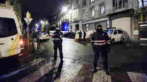Belgian police block a street in central Verviers on Thursday. Two men were killed and a third arrested when police raided an apartment used by suspected Islamist radicals.