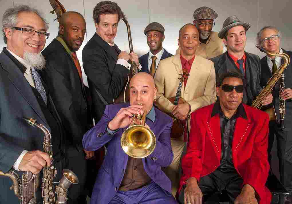 Steven Bernstein (trumpet) and Henry Butler (front row, right) lead the Hot 9.