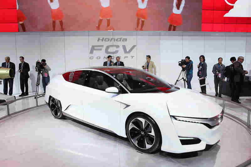 Guests look over the Honda FCV fuel-cell-powered concept car during the media preview.