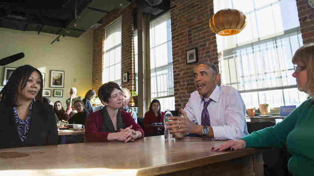 President Obama discussed the need for paid sick leave with women at Charmington's Cafe in Baltimore Thursday. With him are Vika Jordan (from left), Amanda Rothschild and Mary Stein.