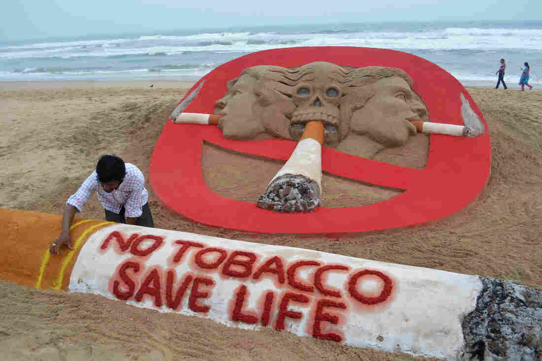 Indian sand artist Sudersan Pattnaik touches up his sculpture for World No Tobacco Day at Golden Sea Beach in Puri, India.