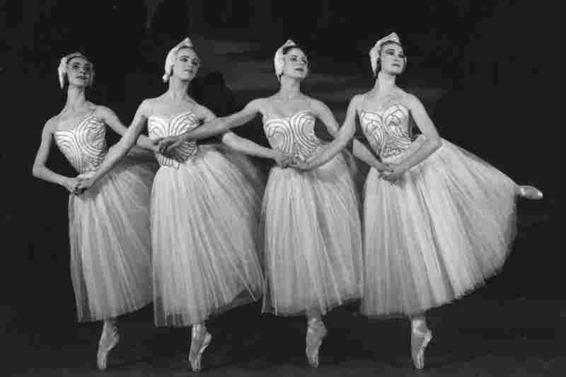 Four cygnets dance in a 1950 production of Swan Lake at Sadler's Wells Theatre in London.