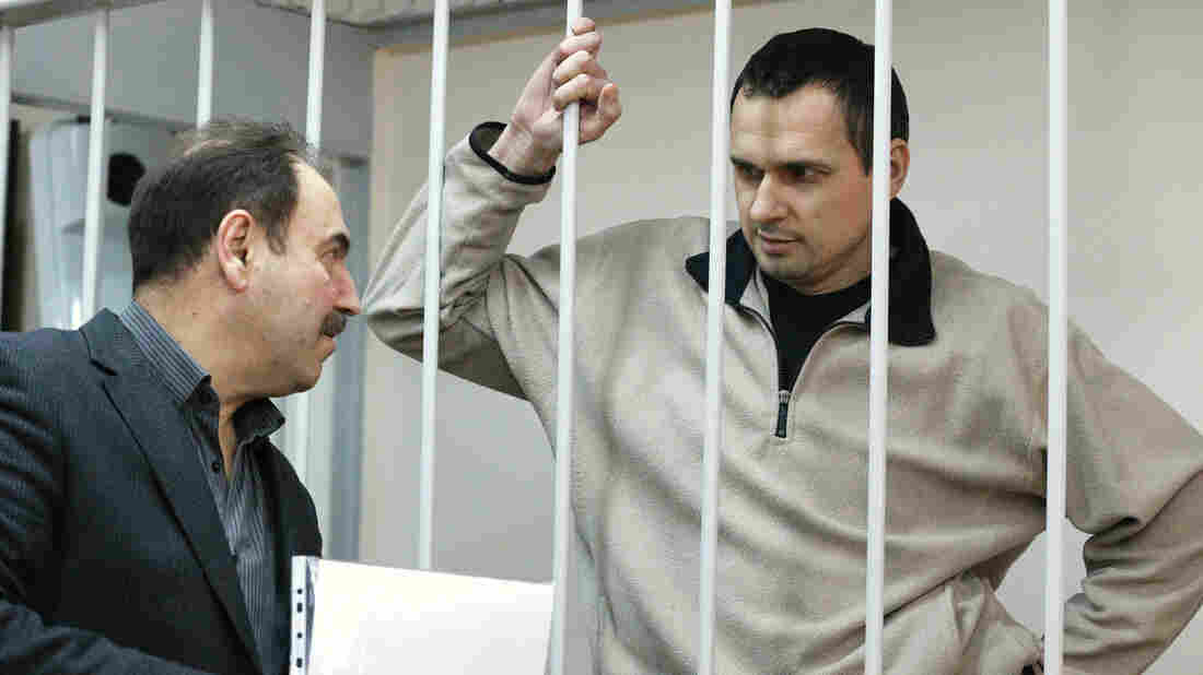 Ukrainian film director Oleg Sentsov (right), was arrested on charges of terrorism last year in Crimea shortly after Russia seized it from Ukraine. He's shown here at a hearing at Moscow's Lefortovo District Court on Dec. 26, 2014.