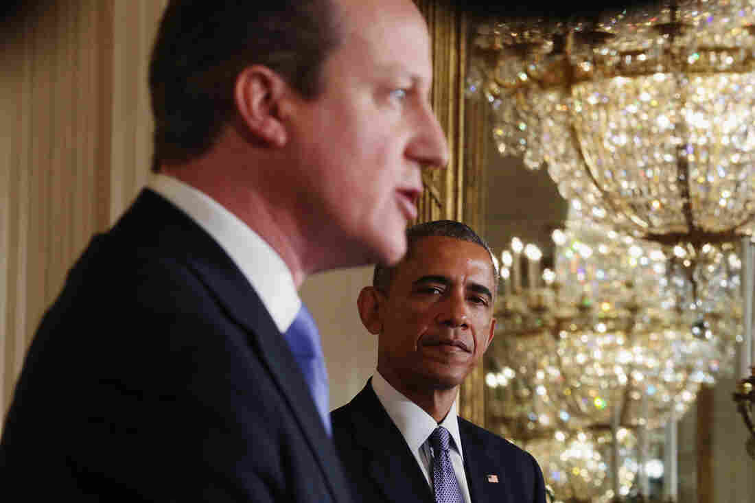 British Prime Minister David Cameron speaks as President Obama looks on during a joint news conference in the East Room of the White House on Friday.