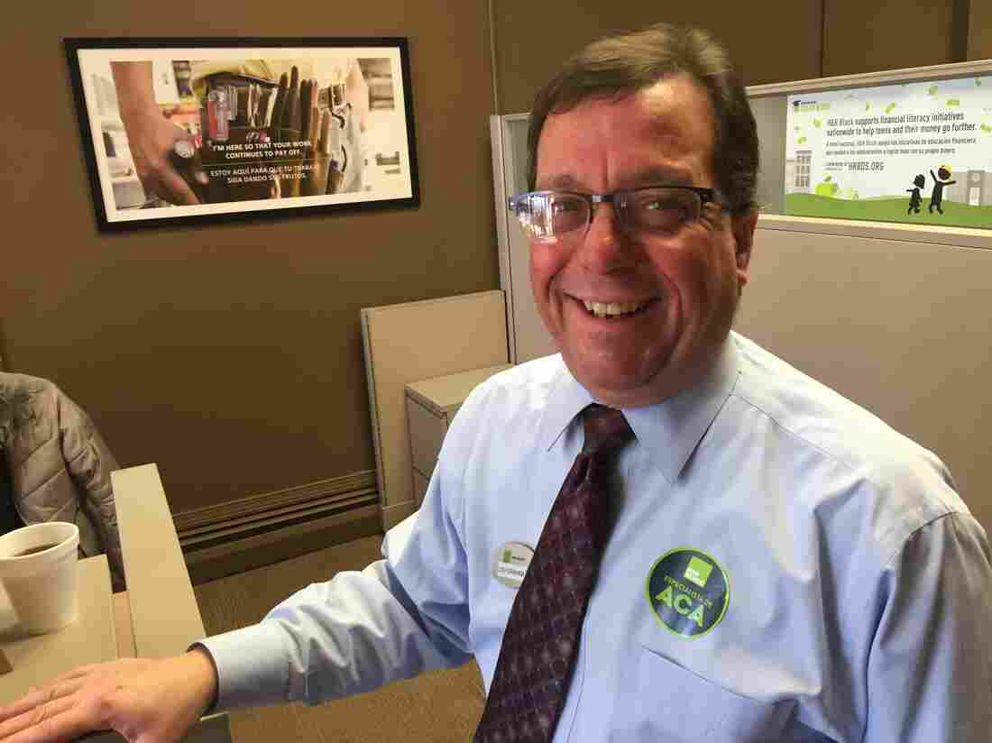 Lou Graham prepares taxes in Connecticut and is ready to answer client questions about the Affordable Care Act.