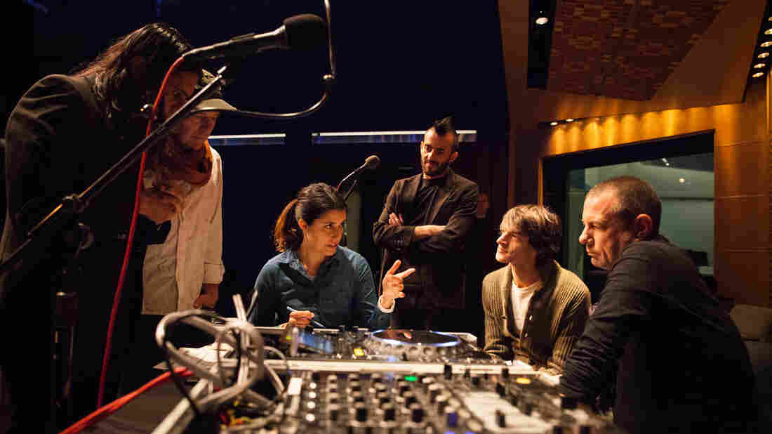 All Things Considered director Monika Evstatieva offers a little last-minute advice to the day's in-house band, Thievery Corporation.