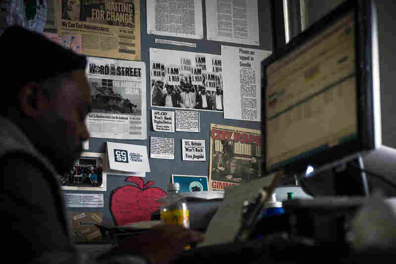 Simmons works at his desk at the office for Word on the Street, Baltimore's newspaper for the homeless, covering issues of homelessness and poverty.