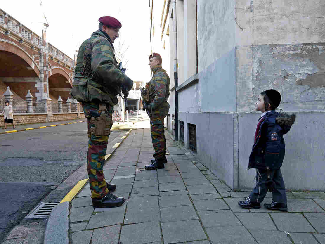 Belgian paratroopers guard outside a Jewish school in the central city of Antwerp on Saturday, a day after authorities made several arrests of alleged Islamist extremists who they say were plotting attacks.