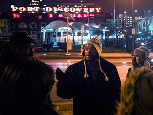 """Tony Simmons leads a group of Johns Hopkins University students on a """"justice walk"""" in downtown Baltimore, during which they learn about public policy, providing services, and the connections between income inequality and health."""