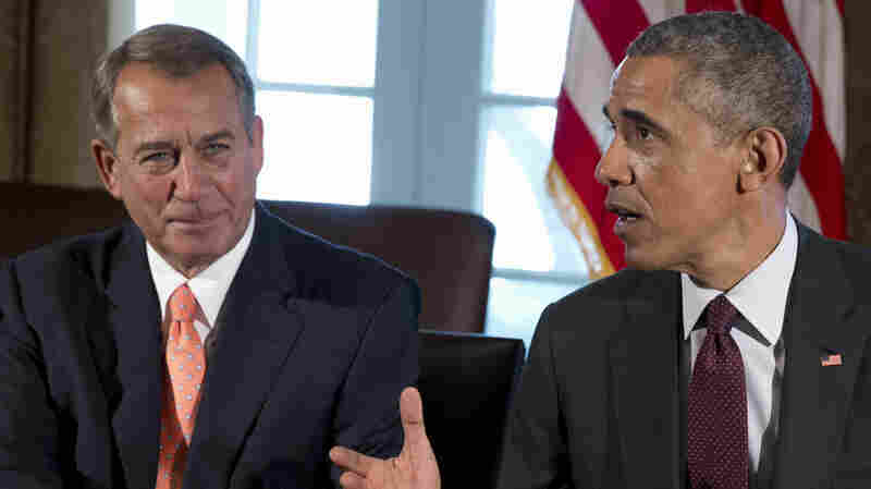 House Speaker John Boehner listens as President Obama speaks to media during a bipartisan, bicameral leadership meeting at the White House this week. Boehner and others have reacted dismissively to Obama's tax overhaul plan.