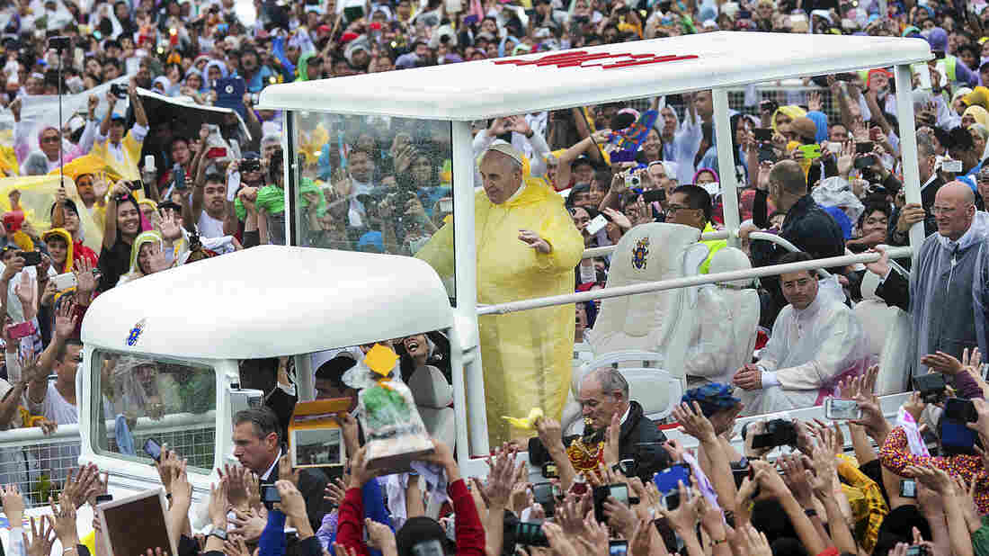 Pope Francis waves to the crowd as he arrives at Quirino Grandstand to celebrate his final Papal Mass in Manila, Philippines, on Sunday. In his homily, Francis warned about the Philippine government's