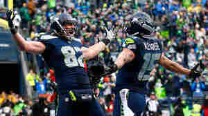 Luke Willson (#82) of the Seattle Seahawks celebrates after scoring on a two-point conversion during the fourth quarter of the 2015 NFC Championship game against the Green Bay Packers on Sunday. Seattle won 28-22.