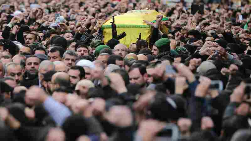 Lebanese Hezbollah supporters carry the coffin of Jihad Mughniyeh during his funeral in Beirut on Monday. Mughniyeh was one of six ranking members of Hezbollah killed in a suspected Israeli strike Sunday. Iran says a general of its elite Revolutionary Guards was also killed.