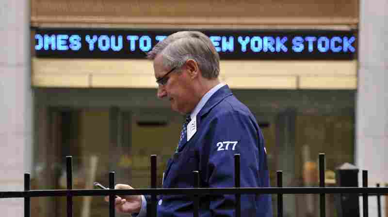 A trader stands outside the New York Stock Exchange on Oct. 31, 2012.