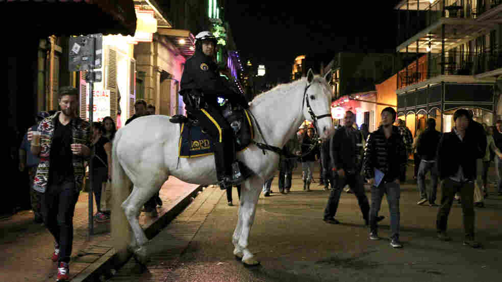 New Orleans police officer Patrick Schneider patrols Bourbon Street in the heart of the French Quarter on Saturday.
