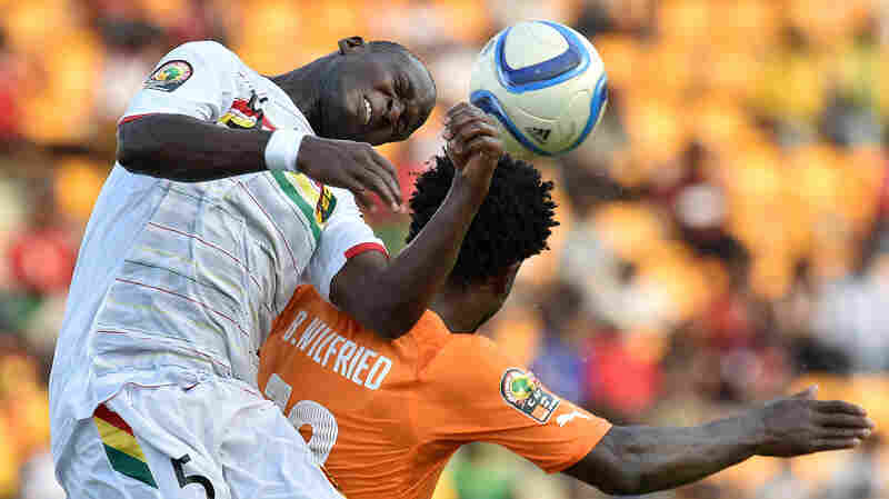 Guinea's defender Fode Camara (left) heads the ball over Ivory Coast's forward Wilfried Bony in the Africa Cup of Nations tournament.