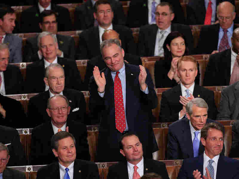 Sen. Tim Kaine, D-Va., applauds during the president's State of the Union address. Not every member of Congress was so moved.