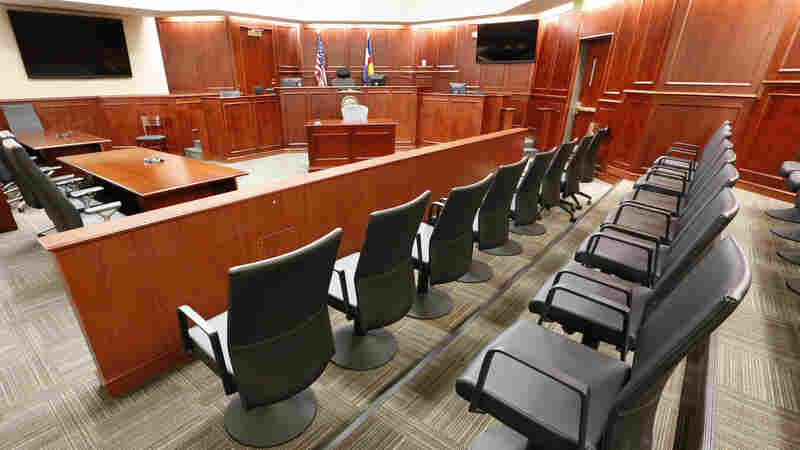 A view of the jury box, right, inside Courtroom 201, where