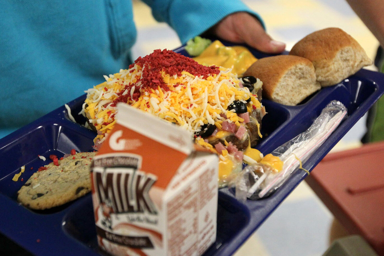 A baked potato with toppings on a lunch tray at a school in Wisconsin. Students are less likely to eat fruits and vegetables if they're rushing to get to recess, researchers say.
