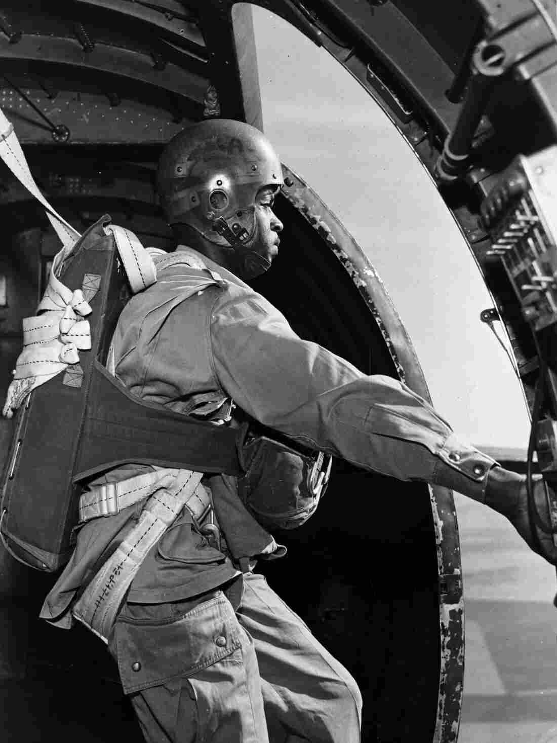 Smokejumper Jesse Mayes preparing to jump from a C-47.