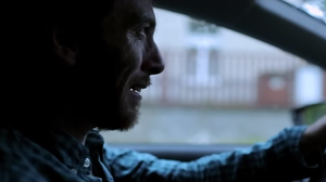 "A man weeps in his car in a scene from the Kishi Bashi video for the song ""In Fantasia."""