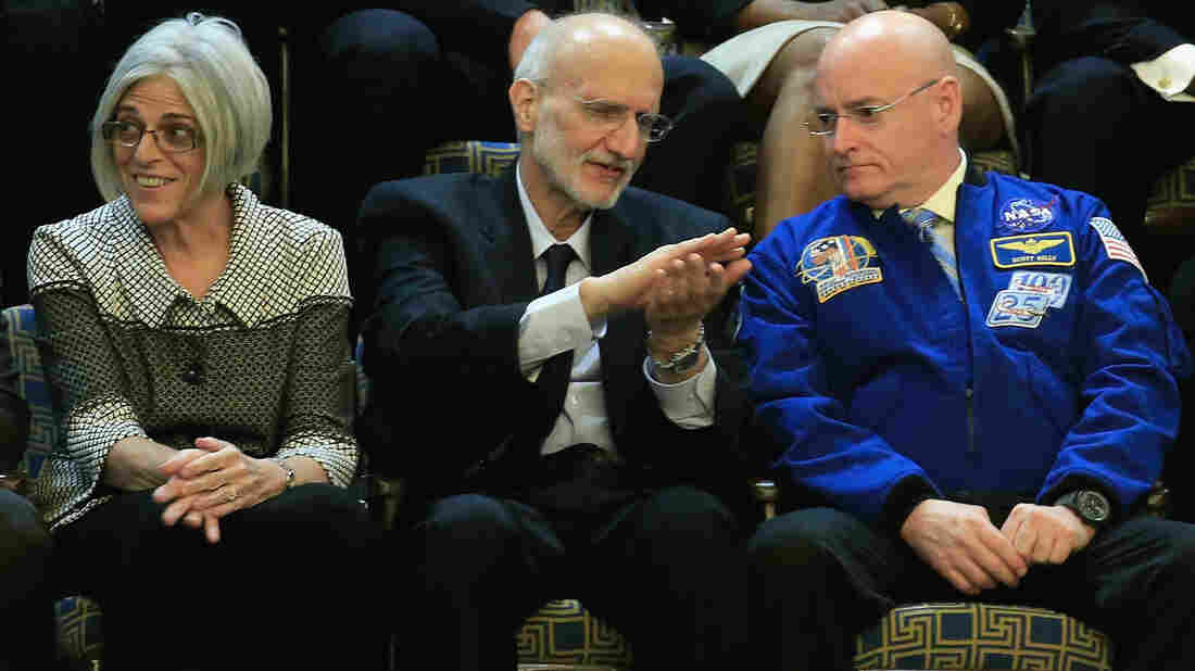 Alan Gross (center), recently freed after being held in Cuba, speaks with NASA astronaut Scott Kelly before the start of the State of the Union speech in the House chamber of the U.S. Capitol. At left is Judy Gross.