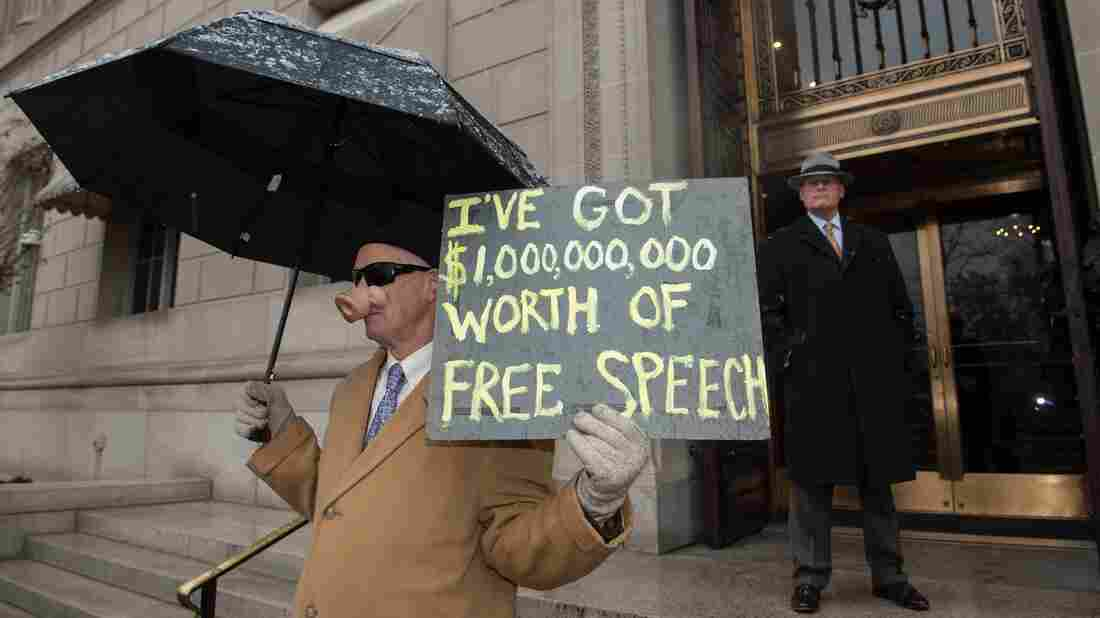 A demonstrator rallies outside the U.S. Chamber of Commerce against the Supreme Court's decision in favor of Citizens United five years ago. Eight protesters at the Supreme Court were arrested and charged.