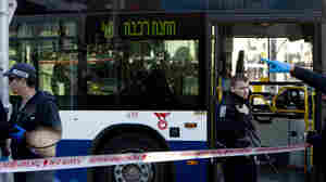 Israeli police officers secure the scene of the stabbing attack Wednesday in Tel Aviv, Israel.