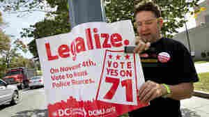 Adam Eidinger, chairman of the D.C. Cannabis Campaign, puts up Initiative 71 posters in October. The measure to legalize possession of up to 2 ounces of marijuana was approved by a wide margin of local voters.
