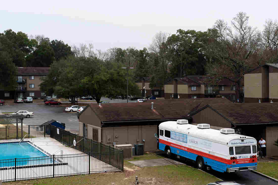 """Dr. Nancy Hardt's free """"clinic on wheels,"""" parked in December at an apartment complex in Gainesville, Fla., gets about 5,000 visits from patients each year."""