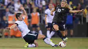 Dozens of elite women's soccer players have ended their fight against the use of turf at this summer's Women's World Cup. The plaintiffs included Abby Wambach, seen here in a 2013 US Women's National Team game.