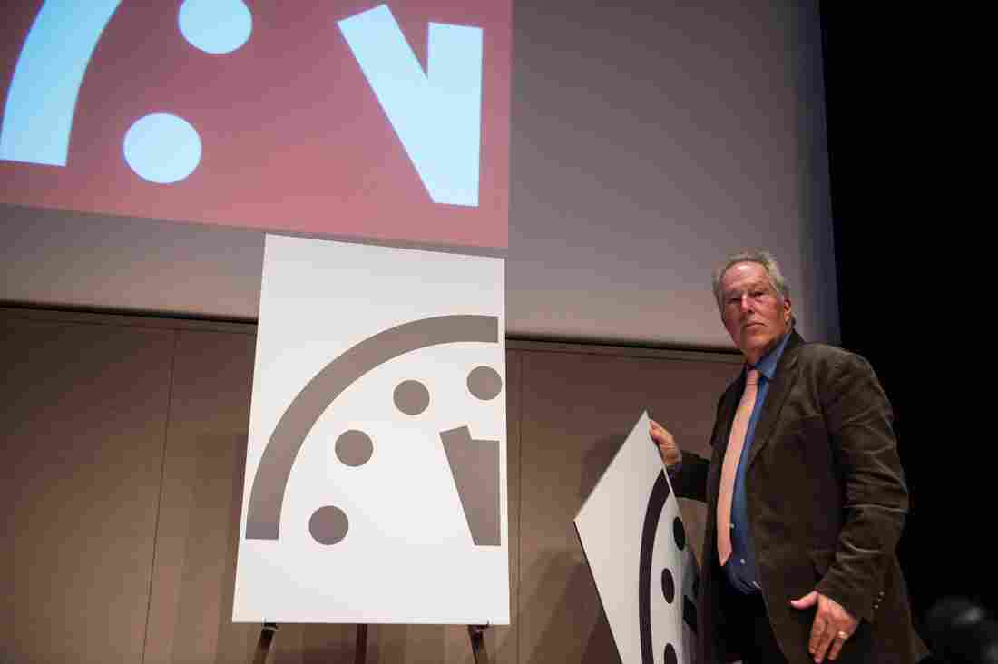"""Professor Richard Somerville of the University of California in San Diego on Thursday unveils the """"Doomsday Clock"""" showing a move toward disaster."""