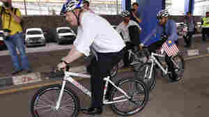 London Mayor Boris Johnson rides a bicycle on Dec. 1 during a city tour in downtown Kuala Lumpur, Malaysia.