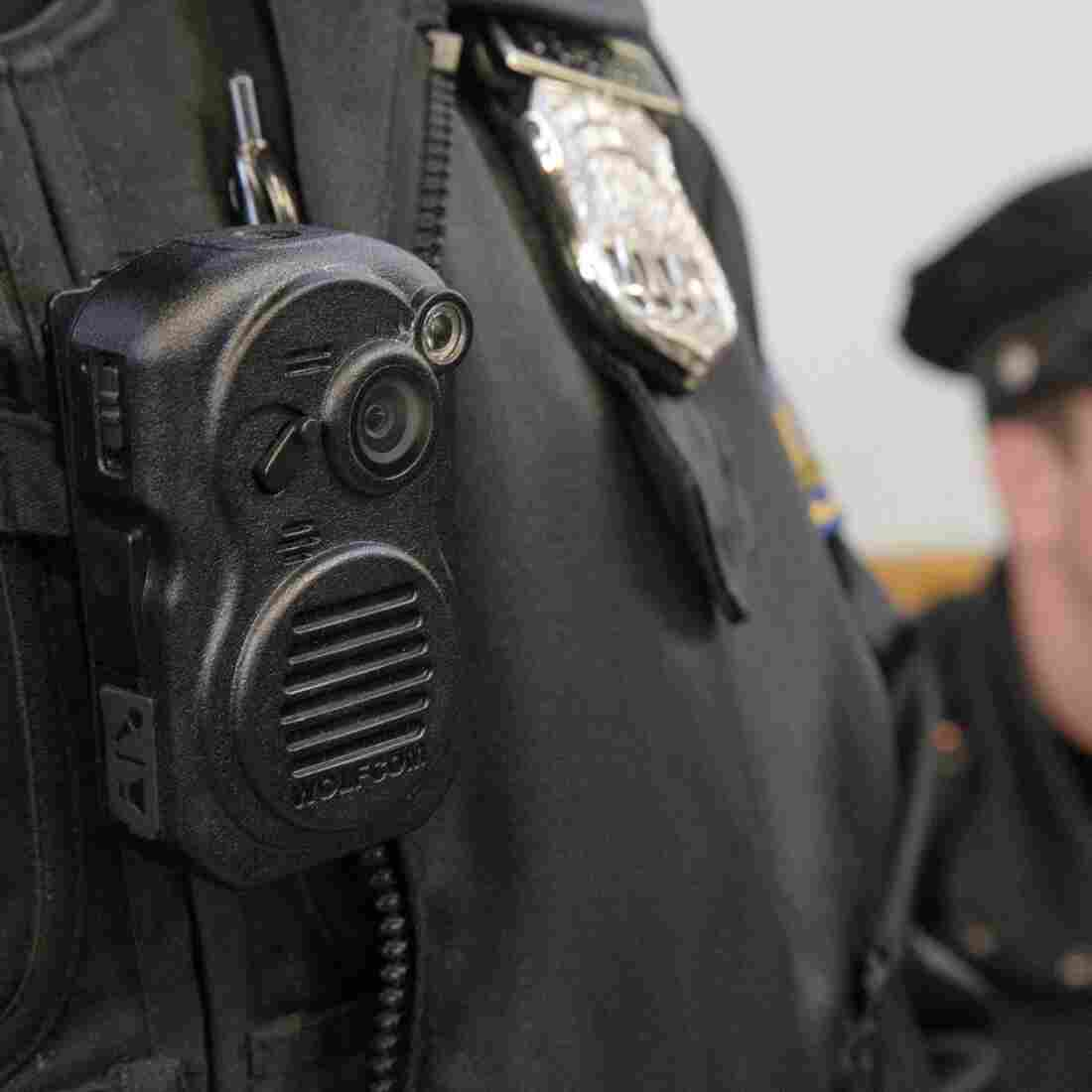 A Philadelphia police officer demonstrates a body-worn camera being used as part of a pilot project last December.
