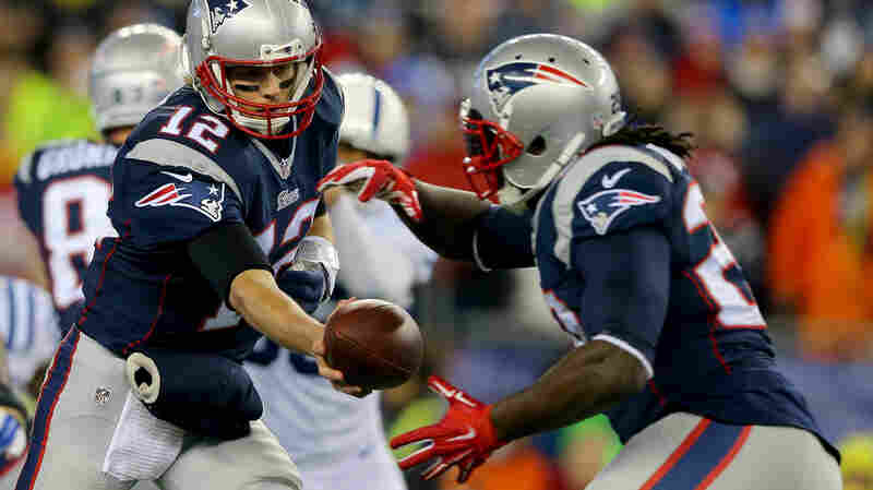 Tom Brady of the New England Patriots hands the ball off to LeGarrette Blount during the AFC Championship Game. The Patriots are being investigated because of game balls that were improperly inflated.