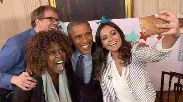 President Obama poses for a selfie after being interviewed by YouTube stars GloZell Green (left), Hank Green and Bethany Mota.