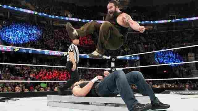 """WWE fighter Bray Wyatt, """"The Eater Of Worlds,"""" jumps on fighter """"Dean Ambrose."""""""