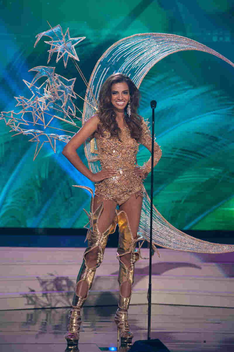 Rathi Menon, Miss Singapore 2014. There is a joy in this outfit that I think can only come from knowing you are strapped to a huge amount of pointy wire.