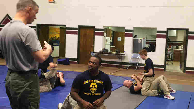 The Akron Police Department training class works out at Kent State Basic Police Officer Training Academy. Donald Clayton is the only African-American in the class of 20.