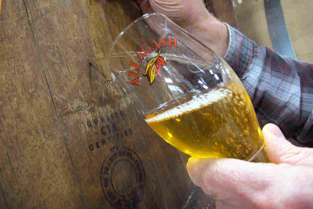 Allagash Brewer Jason Perkins tests a coolship beer brewed and spontaneously fermented this past fall.