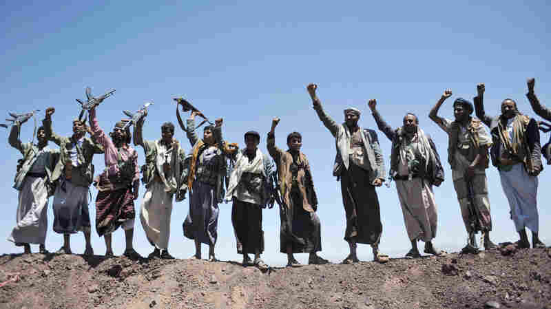 Shiite Houthi rebels chant slogans after taking over a government military compound in Yemen's capital, Sanaa, in September. The group forced the country's president to resign on Thursday, plunging Yemen into uncertainty.