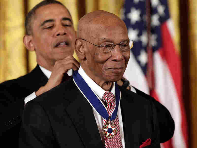 President Barack Obama awarded the Presidential Medal of Freedom to Hall of Fame baseball player Ernie Banks in November 2013.