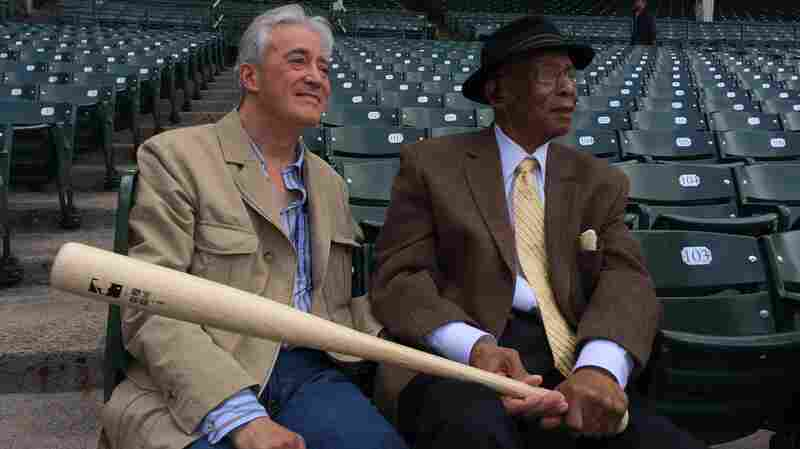 "Chicago Cub Ernie Banks, right, told NPR's Scott Simon, left, in 2014 that he had a lot of fun winning games, but the main thing in his life was ""making friends."""