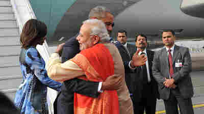 President Obama and first lady Michelle Obama are greeted by Indian Prime Minister Narendra Modi in New Delhi on Sunday.