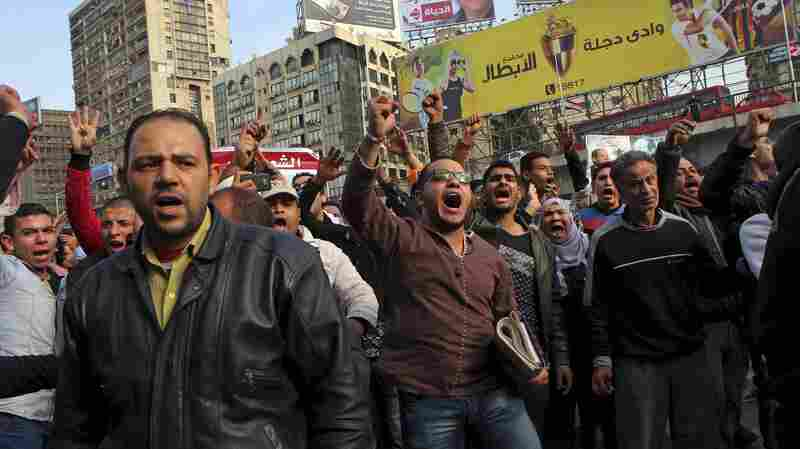 Protester chant slogans in downtown Cairo, Egypt, on Sunday to mark the fourth anniversary of of the 2011 uprising that toppled President Hosni Mubarak. Several people have been killed in clashes with security forces.