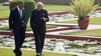 Indian Prime Minister Narendra Modi and President Barack Obama walk through the gardens between official meetings at Hyderabad House in New Delhi on Sunday, the first day of Obama's three-day trip.
