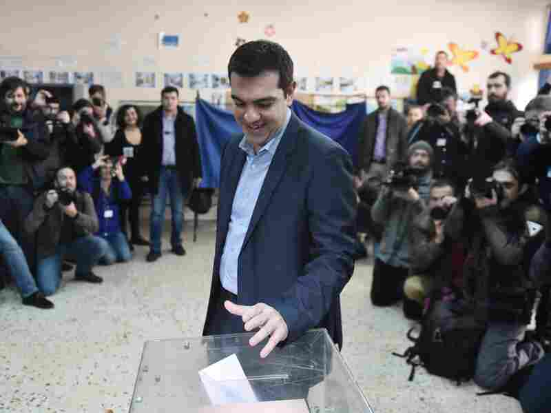 The leader of Greece's left-wing Syriza party Alexis Tsipras casts his ballot in Athens on Sunday. His anti-austerity party was ahead in earlier polling.