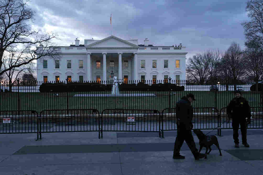 Secret Service officers patrol in front of the White House on Jan. 20.